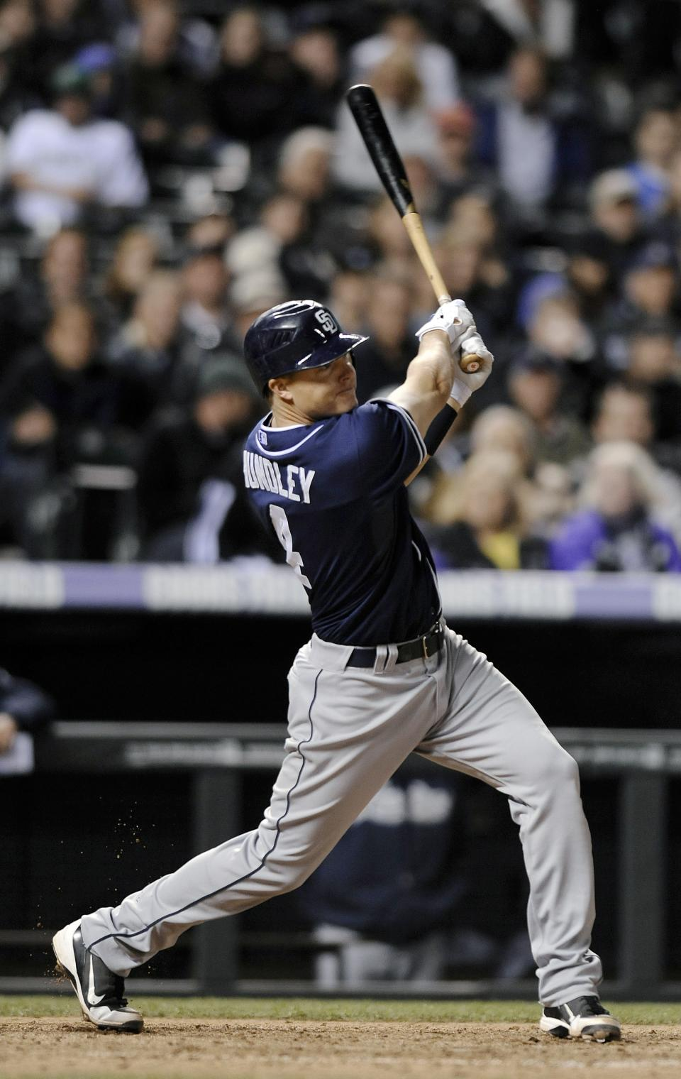 San Diego Padres Nick Hundley hits a solo home run in the ninth inning of a baseball game against the Colorado Rockies on Tuesday, April 17, 2012 in Denver. The Rockies won 5-3. Jamie Moyer became the oldest pitcher to win a major league game. (AP Photo/Chris Schneider)
