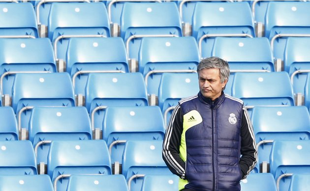 Real Madrid's coach Mourinho watches players warm up during a training session at Etihad Stadium in Manchester