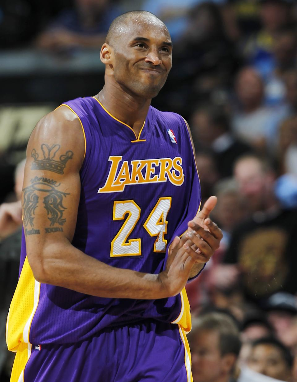 Los Angeles Lakers guard Kobe Bryant reacts after missing a shot against the Denver Nuggets in the fourth quarter of Game 3 of the Nuggets' 99-84 victory in the teams' first-round NBA playoff series in Denver on Friday, May 4, 2012. (AP Photo/David Zalubowski)