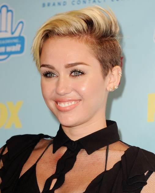 Miley Cyrus poses in the press room at the 2013 Teen Choice Awards at Gibson Amphitheatre on August 11, 2013 in Universal City, Calif -- Getty Premium
