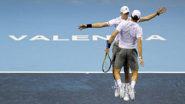 Bob Bryan and Mile Bryan from USA, celebrate after wining their doubles final match against Eric Butorac from USA and Jean Julie Rojer from Netherlands Antilles at ATP 500 World Tour Valencia Open tennis tournament, in Valencia, Spain, Sunday, Nov. 6, 2011. Bryan brothers woon the match 6-4, 7-6. (AP Photo/ Fernando Bustamante)