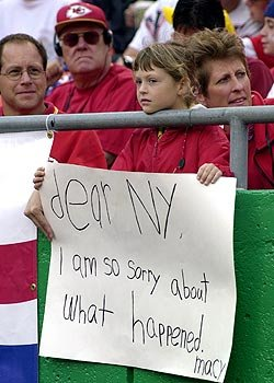A young Kansas City Chiefs' fan offers condolences to New York City. (Getty Images)