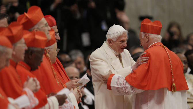 Newly-elected Cardinal Ricardo Ezzati Andrello, right, is greeted by Pope Emeritus Benedict XVI after he received the red three-cornered biretta hat during a consistory inside the St. Peter's Basilica at the Vatican, Saturday, Feb.22, 2014. Pope Francis is putting a personal imprint on the group of men who will choose his successor, tapping like-minded cardinals from some of the world's smallest, most remote and poverty-wracked nations to help him run the Catholic Church. (AP Photo/Alessandra Tarantino)