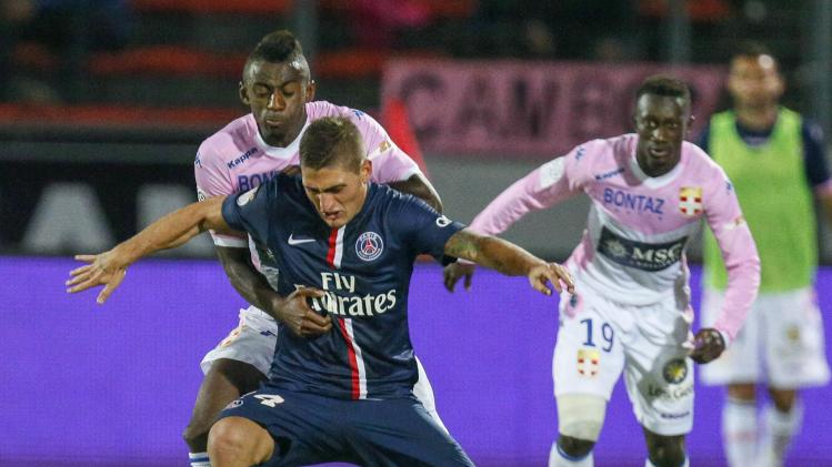 Verratti of Paris St-Germain challenges N'Sikulu of Evian Thonon Gaillard during their French Ligue 1 soccer match in Annecy