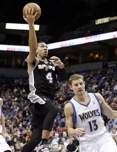 Rubio's triple-double lifts Wolves over Spurs