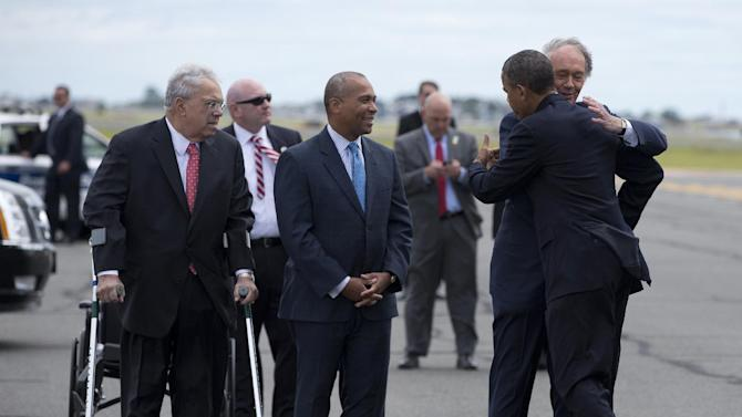 President Barack Obama is greeted by Massachusetts Senate candidate, Rep. Ed Markey, right, accompanied by Boston Mayor Thomas Menino, left, and Massachusetts Gov Deval Patrick, center, upon his arrival at Logan International Airport in Boston, Wednesday, June 12, 2013. Obama traveled to Boston to campaign for Markey's Massachusetts Democratic Senate campaign. (AP Photo/Evan Vucci)