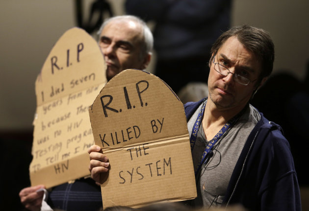 Protesters display placards while demonstrating during an address by House majority leader Eric Cantor, of Va., at the John F. Kennedy School of Government at Harvard University, in Cambridge, Mass.,