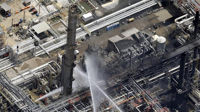 A chemical plant fire is seen in an aerial photo about twenty miles southeast of Baton Rouge, in Geismer, La., Thursday, June 13, 2013. The plant makes highly flammable gases that are basic building blocks in the petrochemical industry. (AP Photo/Gerald Herbert)