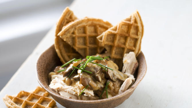 In this image taken on December 3, 2012, rotisserie chicken with waffles and gravy is seen served in a bowl in Concord, N.H. (AP Photo/Matthew Mead)