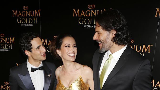 IMAGE DISTRIBUTED FOR MAGNUM - Couture designer Zac Posen, left, actress Caroline Correa AND actor Joe Manganiello arrive on the gold carpet of the As Good As Gold premiere, a new short film starring Joe Manganiello that celebrates the U.S. arrival of MAGNUM Gold?! Ice Cream. The film debuted during the Tribeca Film Festival Thursday, April 18, 2013 in New York. Visit MagnumIceCream.com for more information  (Photo by Jason DeCrow/Invision for MAGNUM/AP Images)