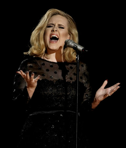 "FILE - This Feb. 12, 2012 file photo shows Adele performing during the 54th annual Grammy Awards in Los Angeles. Adele has the year's top-selling album on iTunes. Her ""21,"" which recently passed the 10 million mark in sales, topped the list even though it was first released at the top of 2011. It remained popular this year, particularly after she nabbed five Grammys in February. (AP Photo/Matt Sayles, file)"