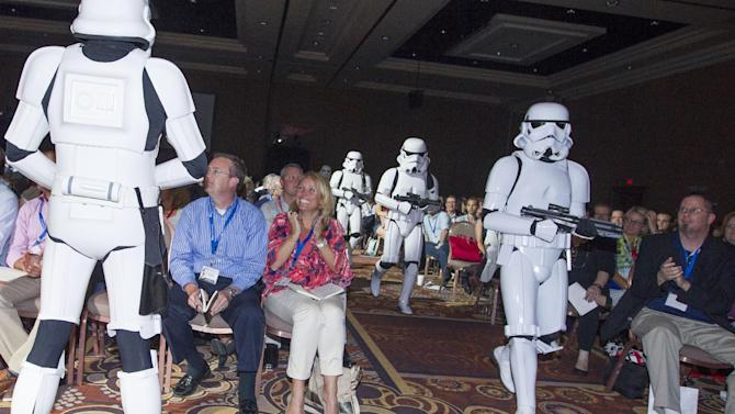 IMAGE DISTRIBUTED FOR DISNEY CONSUMER PRODUCTS - Twenty Stormtroopers take over the stage during a private Disney event at the Licensing Expo, Monday June 17, 2013 at the Mandalay Bay Convention Center in Las Vegas. This surprise grand finale, presented to more than 1,500 licensees, demonstrates a new era of merchandising potential for Disney Consumer Products' robust franchise portfolio, which now includes the Star Wars franchise. (Photo by Eric Jamison/Invision for Disney Consumer Products/AP Images)