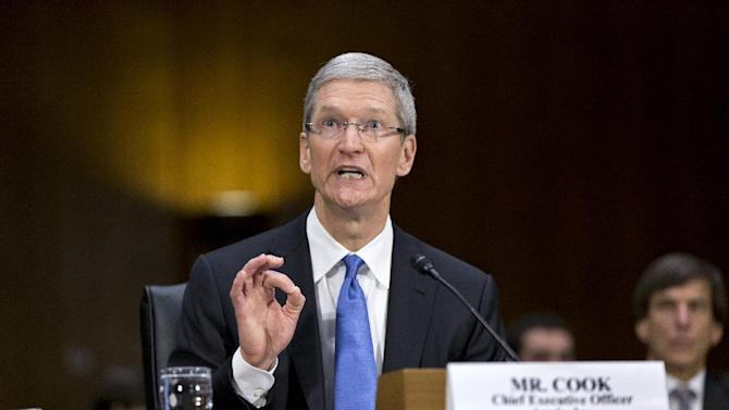 Apple CEO Tim Cook testifies on Capitol Hill in Washington, Tuesday, May 21, 2013, before the Senate Homeland Security and Governmental Affairs Permanent subcommittee on Investigations as lawmakers examine the methods employed by multinational corporations to shift profits offshore and how such activities are affected by the Internal Revenue Code. Lawmakers want to know the tax strategy of how Apple, the world's most valuable company, based in Cupertino, Calif., holds a billion dollars in an Irish subsidiary as a tax strategy, according to a report issued this week by the subcommittee. (AP Photo/J. Scott Applewhite)