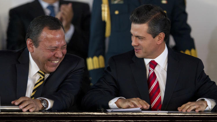 Mexico's President Enrique Pena Nieto, right, speaks to President of the Democratic Revolution Party (PRD) Jesus Zambrano during an event to announce an education reform proposal in Mexico City, Monday, Dec. 10, 2012. Pena Nieto is proposing sweeping reforms to the public education system widely seen as moribund, taking on Elba Esther Gordillo, an iron-fisted union leader who is considered the country's most powerful woman and the main obstacle to change. (AP Photo/Alexandre Meneghini)