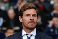 Tottenham Hotspur&#39;s Portuguese manager Andre Villas-Boas looks on before the English Premier League football match between Tottenham Hotspur and Queens Park Rangers at White Hart Lane in north London. Villas-Boas revelled in his first home win as Tottenham manager, but was quick to praise the goal-scoring knack and consistency of England striker Jermain Defoe