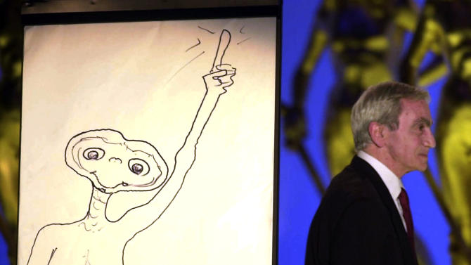 "FILE - This April 10, 2002 file photo shows special effects artist Carlo Rambaldi  walking on stage after drawing a cartoon of ET during the Italian David Di Donatello cinema awards in Rome's Cinecitta' studios.  Rambaldi who won three Oscars for the special effecs of  ""King Kong"" by John Guillermin, ""Alien"" by Ridley Scott and  ""E.T. the Extra-Terrestrial"" by Steven Spielberg, died in Lamezia Terme, Italy, Friday Aug. 10, 2012. He was 86. (AP Photo/Gregorio Borgia, FILE)"