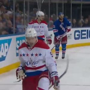Kuznetsov fights off check and buries rebound