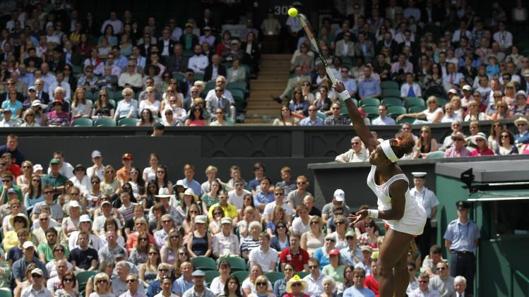 Serena Williams of the United States serves to Mandy Minella of Luxembourg during their Women's first round singles match at the All England Lawn Tennis Championships in Wimbledon, London, Tuesday, June 25, 2013. (AP Photo/Sang Tan)