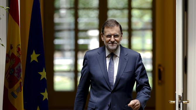 Spain's PM Rajoy enters before his news conference after weekly cabinet meeting at the Moncloa Palace in Madrid