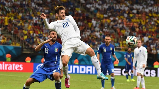 England midfielder Adam Lallana (C) gets ahead of Italy defender Andrea Barzagli during the World Cup Group D match at the Amazonia Arena in Manaus on June 14, 2014