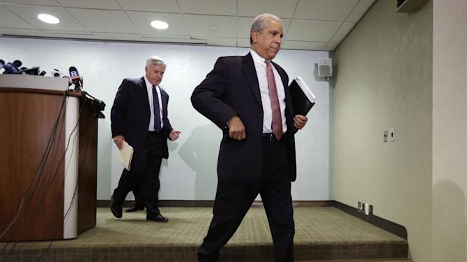 Defense lawyers for former Penn State President Graham Spanier, John E. Riley, left, and Timothy Lewis, center, exit a news conference Wednesday, Aug. 22, 2012, in Philadelphia. Attorneys for Spanier dispute allegations in the university-funded investigation by former FBI director Louis Freeh, that Spanier covered up reports of child sex abuse involving convicted former assistant football coach Jerry Sandusky. (AP Photo/Matt Rourke)