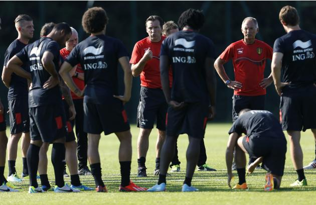 Belgian national soccer team coach Wilmots gives instructions to his players during a training session in Brussels