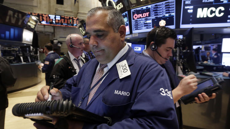 Trader Mario Innella, center, works on the floor of the New York Stock Exchange Thursday, Aug. 21, 2014. U.S. stocks are opening higher, pushing the Standard & Poor's 500 index closer toward another record high. (AP Photo/Richard Drew)