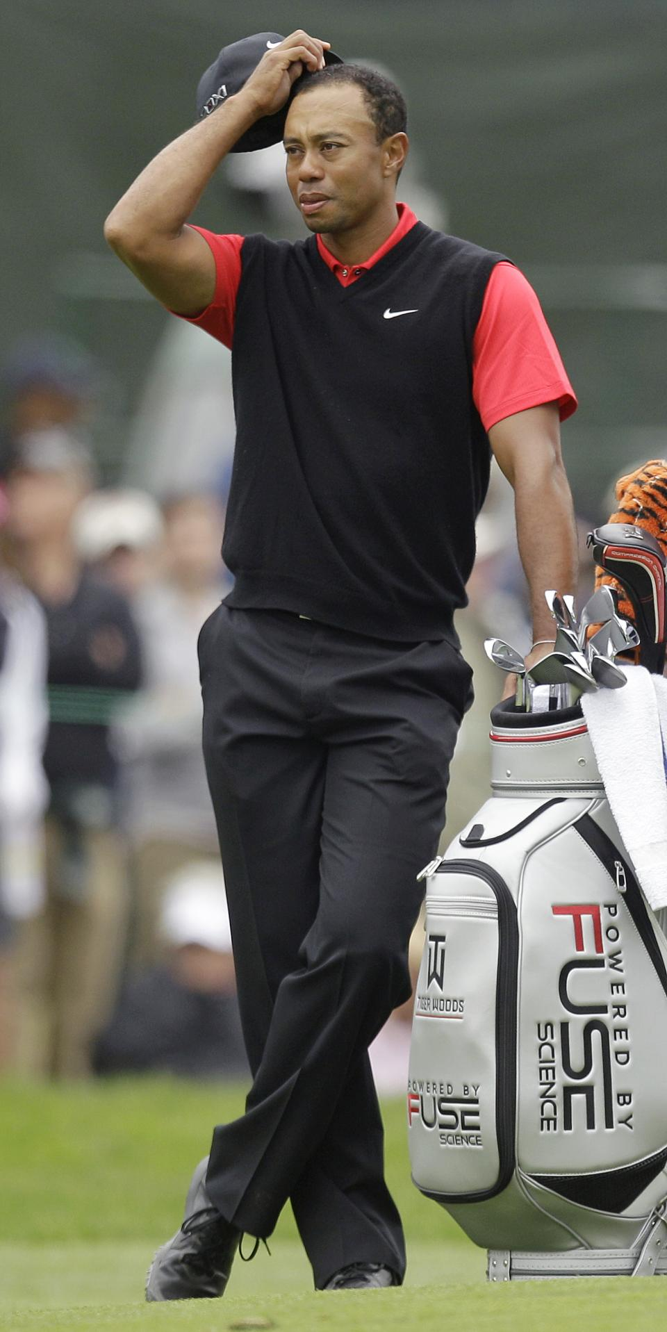Tiger Woods waits to hit on the sixth hole during the fourth round of the U.S. Open Championship golf tournament Sunday, June 17, 2012, at The Olympic Club in San Francisco. (AP Photo/Ben Margot)