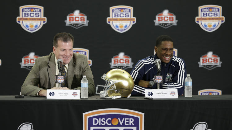 Notre Dame offensive coordinator Chuck Martin, left, and quarterback Everett Golson laugh as they answer questions during a news conference, Friday, Jan. 4, 2013 in Fort Lauderdale, Fla. Notre Dame is scheduled to play Alabama on Monday, Jan. 7, in the BCS national championship NCAA college football game. (AP Photo/Wilfredo Lee)