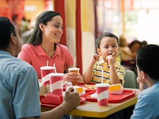 family at a fast food restaurant