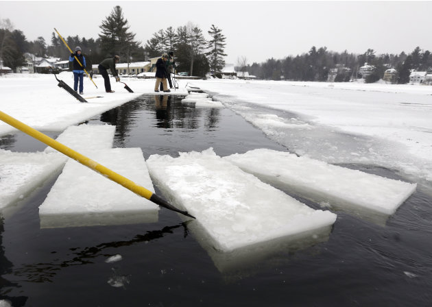 A volunteer moves blocks of ice that have been cut from Lake Flower that will be used for the Saranac Lake Winter Carnival ice palace on Monday, Jan. 28, 2013, in Saranac Lake, N.Y. (AP Photo/Mike Gro