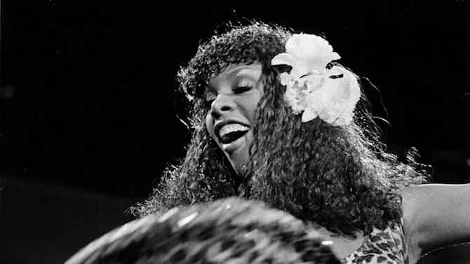 "FILE - In this Aug. 11, 1979 file photo, singer Donna Summer swings the skirt of her leopard-print dress during her concert at the Universal Amphitheater in Los Angeles, Calif. Summer, the Queen of Disco who ruled the dance floors with anthems like ""Last Dance,"" ""Love to Love You Baby"" and ""Bad Girl,"" has died. Her family announced her death in a statement Thursday, May 17, 2012.  She was 63. (AP Photo/File)"
