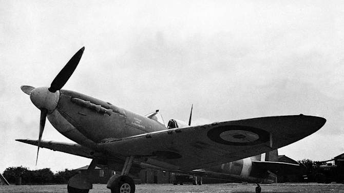 FILE - In this Sept. 28, 1941 file photo, Spitfires, subscribed for by the people of Assam, are now operating with fighter command of the Royal Air Force, at an airfield somewhere in England. Myanmar signed a deal with a British aviation enthusiast David J. Cundall to allow the excavation of a World War II treasure: dozens of Spitfire fighter planes buried by the British almost 70 years ago. Cundall discovered the locations of the aircraft after years of searching. The planes are believed to be in good condition, since they were reportedly packed in crates and hidden by British forces to keep them out of the hands of invading Japanese. (AP Photo)