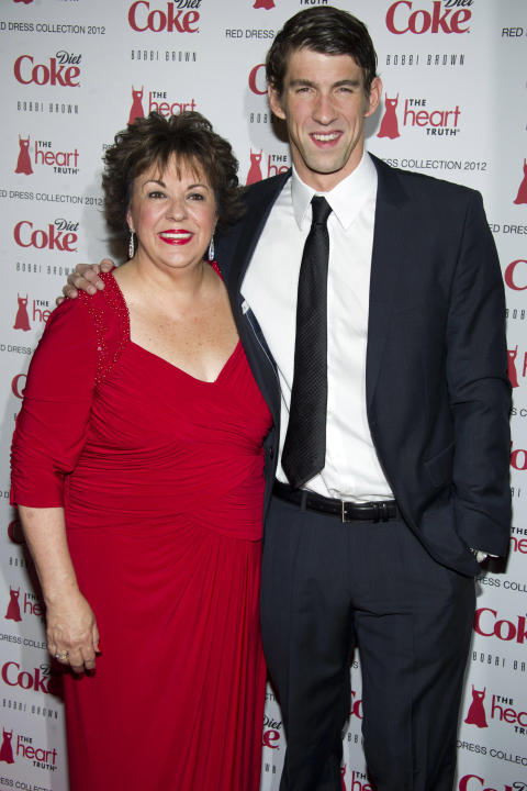 Michael Phelps and his mother Debbie Phelps attend the Heart Truth's Red Dress Collection during Fashion Week in New York, Wednesday, Feb. 8, 2011. (AP Photo/Charles Sykes)