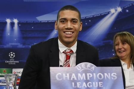 Manchester United's defender Chris Smalling leaves a news conference in Leverkusen November 26, 2013. REUTERS/Wolfgang Rattay/Files