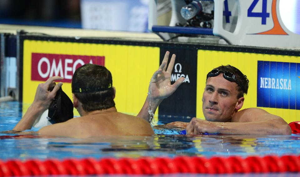Ryan Lochte, right, reacts after winning the men's 400-meter individual medley final at the U.S. Olympic swimming trials, Monday, June 25, 2012, in Omaha, Neb. At left is Michael Phelps. (AP Photo/Mark J. Terrill)