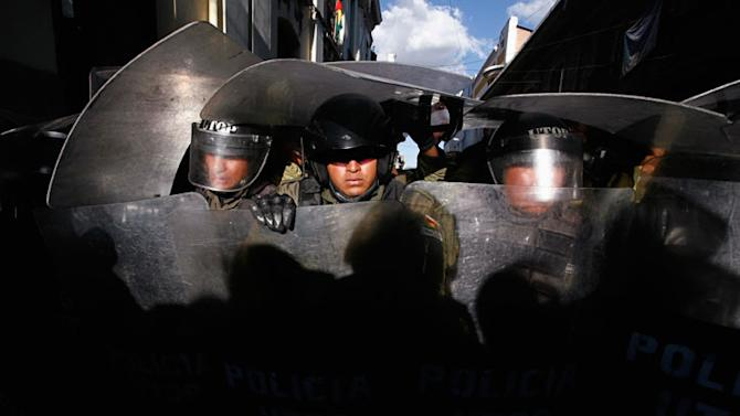 Bolivia's riot policemen take position at a street in La Paz Gaston Brito / Reuters