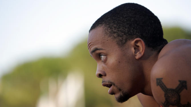 FILE - This Sept. 6, 2009, file photo shows Wallace Spearmon, of United States, reacting after winning the Men's 200 meter event at the IAAF Grand Prix in Rieti,  Italy. With Usain Bolt breaking all the records and Tyson Gay hot on the Jamaican's heels, Spearmon often has been lost in their shadow despite his strong performances. (AP Photo/Riccardo De Luca, File)