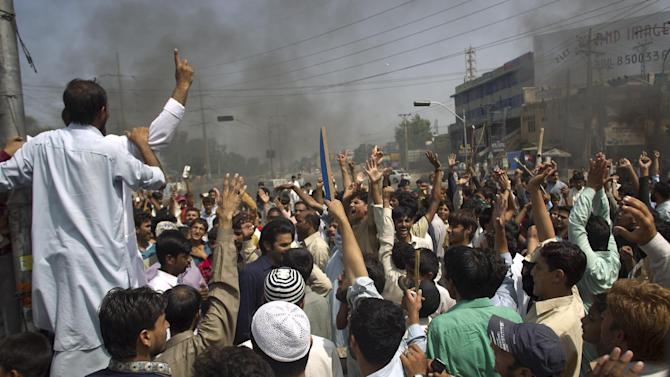 Pakistani protesters shout anti-U.S. slogans at a rally in Rawalpindi, Pakistan on Friday, Sept. 21, 2012. Pakistan has blocked cell phone service in major cities to prevent militants from using phones to detonate bombs during a national day of protest against an anti-Islam film produced in the United States. (AP Photo/B.K. Bangash)