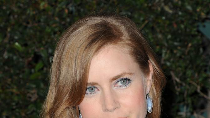"""FILE - In this Feb. 20, 2011 file photo, actress Amy Adams arrives at Vanity Fair Campaign Hollywood at Siren Studios in Los Angeles. Adams, who played a princess in the film """"Enchanted,"""" will be returning to fairy tales this summer, starring opposite Cinderella and a witch. The Public Theater said Tuesday, April 3, 2012, that the three-time Academy Award nominated actress will play The Baker's Wife in its production of Stephen Sondheim's and James Lapine's """"Into the Woods."""" (AP Photo/Katy Winn, file)"""