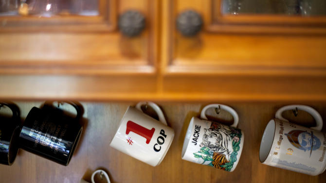 Coffee mugs hang in the kitchen of retired Atlanta police Det. Jaqueline Barber in the home she shares with her daughter and four grandchildren Monday, Oct. 8, 2012, in Fayetteville, Ga. Less than a year after Occupy Atlanta members clashed with police in riot gear in a downtown park, they're now protesting alongside officers to help Barber avoid losing her home to foreclosure. Barber said she is under threat of eviction after her medical bills mounted, partly because of a diagnosis of multiple myeloma, a form of blood cell cancer. If she's evicted, she expects that she will be homeless. (AP Photo/David Goldman)