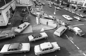 FILE - In this Dec. 23, 1973, file photo, cars line …