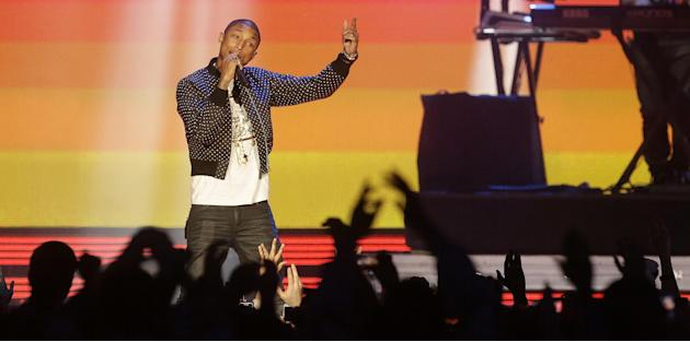 Rapper Pharrell Williams performs before the NBA All Star basketball game, Sunday, Feb. 16, 2014, in New Orleans