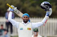 Sri Lanka's Tillakaratne Dilshan celebrates after scoring a century in the first Hobart Test on December 16, 2012. Dilshan and prospective captain Angelo Mathews put on 161 runs before they were separated with the score on 248 as Sri Lanka closed in on the follow-on target