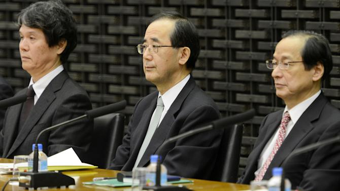 Bank of Japan Gov. Masaaki Shirakawa, center, prepares to attend a meeting with branch managers at its headquarters in Tokyo Tuesday, Jan. 15. 2013. The governor of Japan's central bank says it will persist in easing monetary conditions as it tries to pull the country out of a deflationary slump. (AP Photo/Kyodo News) JAPAN OUT, MANDATORY CREDIT, NO LICENSING IN CHINA, HONG KONG, JAPAN, SOUTH KOREA AND FRANCE