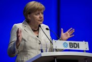 "<p>German Chancellor Angela Merkel addresses the annual meeting of the Federation of German Industries in Berlin. Merkel has said the approach to the proposed EU banking union had to be ""step-by-step and in the correct order and not hasty and not just so we can say 'we have something'.""</p>"