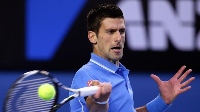 Novak Djokovic of Serbia makes a forehand return to Andy Murray of Britain during the men's singles final at the Australian Open tennis championship in Melbourne, Australia, Sunday, Feb. 1, 2015. (AP Photo/Rob Griffith)