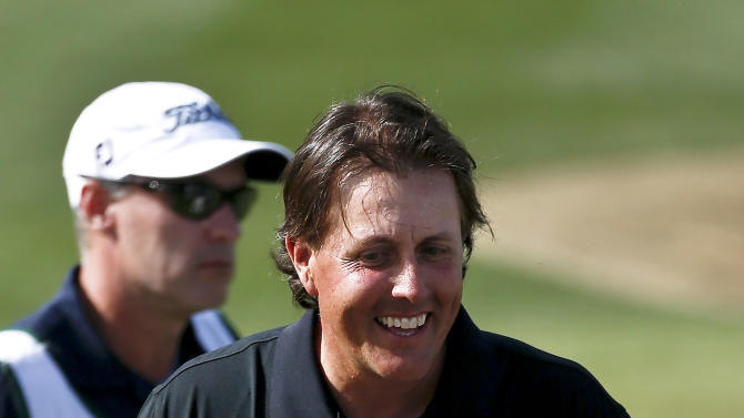 Phil Mickelson smiles after finishing te first round of the Waste Management Phoenix Open golf tournament Thursday, Jan. 31, 2013, in Scottsdale, Ariz. Mickelson shot a course record 11-under par 60 for the round. (AP Photo/Ross D. Franklin)