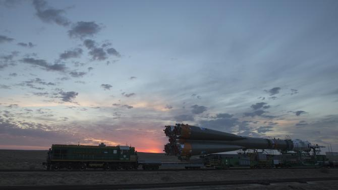 The Soyuz TMA-14M spacecraft is transported to its launch pad at Baikonur cosmodrome