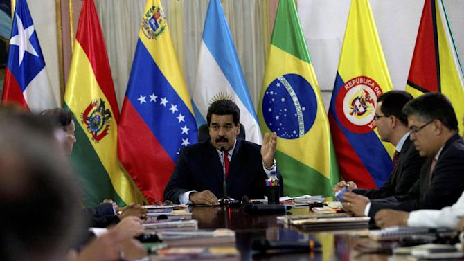 Venezuela's President Nicolas Maduro speaks at a meeting with a South American delegation of foreign ministers at the Miraflores Presidential Palace in Caracas, Venezuela, Tuesday, March 25, 2014. The foreign ministers representing the Union of South American Nations or UNASUR arrived Tuesday aiming to ease political tensions and facilitate dialogue between Venezuela's government and opponents who are urging Maduro's resignation. (AP Photo/Fernando Llano)